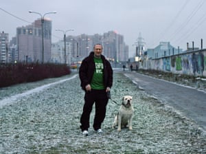 Man with dog in St Petersburg suburb