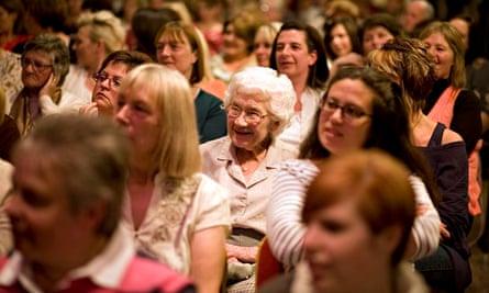 An audience watches psychic Derek Acorah perform