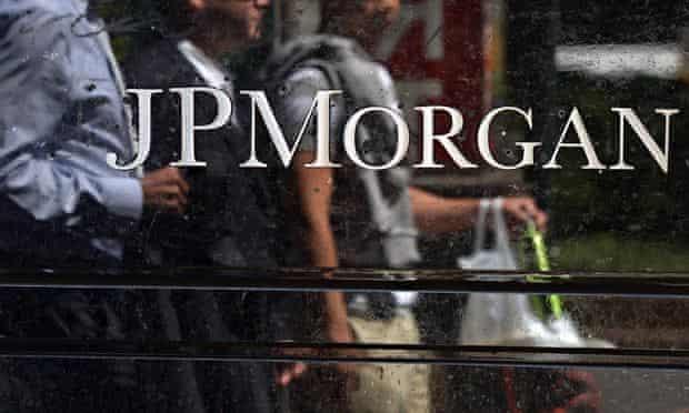 (FILES) People walk by JP Morgan Chase &