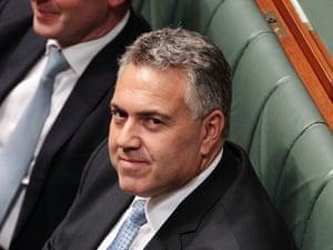 Treasurer Joe Hockey listens to opposition leader Bill Shorten deliver his budget reply speech.