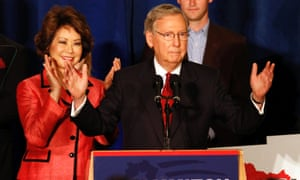 Senator Mitch McConnell and his wife Elaine Chao greet campaign supporters after McConnell defeated Tea Party challenger Matt Bevin in the Kentucky primary