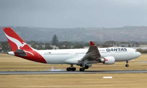 (FILES) This picture taken on December 10, 2013 shows a Qantas flight landing at the Adelaide airport in Adelaide.  Struggling Australian airline Qantas will make dozens of pilots redundant for the first time in 40 years, reports said on May 14, 2014, as it looks to slash costs to contain massive losses. AFP PHOTO / FILES /Saeed KHANSAEED KHAN/AFP/Getty Images