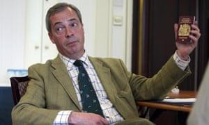 UKIP Leader Nigel Farage holds up his passport during a visit to Belfast