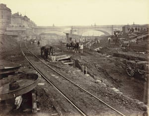 Waterloo Bridge can be seen in the distance behind excavations during the construction of the Metropolitan District Railway in an albumen print made around 1868.