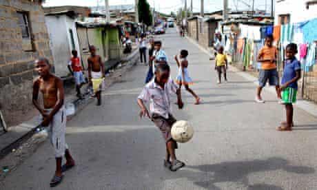 South African boys play street soccer