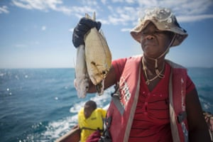 Paulette Coley holds up the catch of the day  Harbour Bay, Jamaica