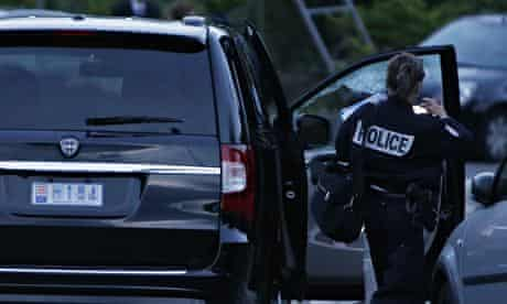 A police officer examining the car of Hélène Pastor after the shooting at l'Archet hospital in Nice