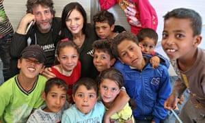 Gaiman and Georgina Chapman with children at a playgroup at Azraq.