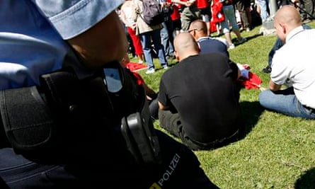 Police watch neo-Nazis during national holiday celebrations on Lake Lucerne's Rütli meadow,