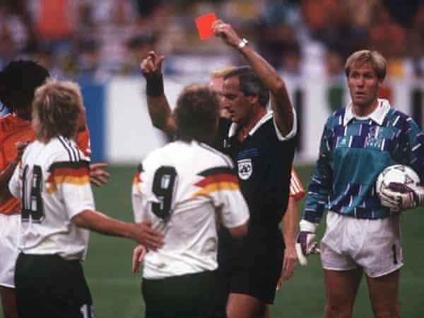 The referee dismisses Rudi Voeller.