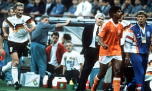 The post-phlegm moment as Rudi Voeller and Frank Rijkaard head towards the dressing room.