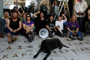 Fired Finance Ministry cleaners blocked the entrance to the ministry on Thursday protesting the Greek government's failure to comply with an Athens court decision earlier this month that they be reinstated