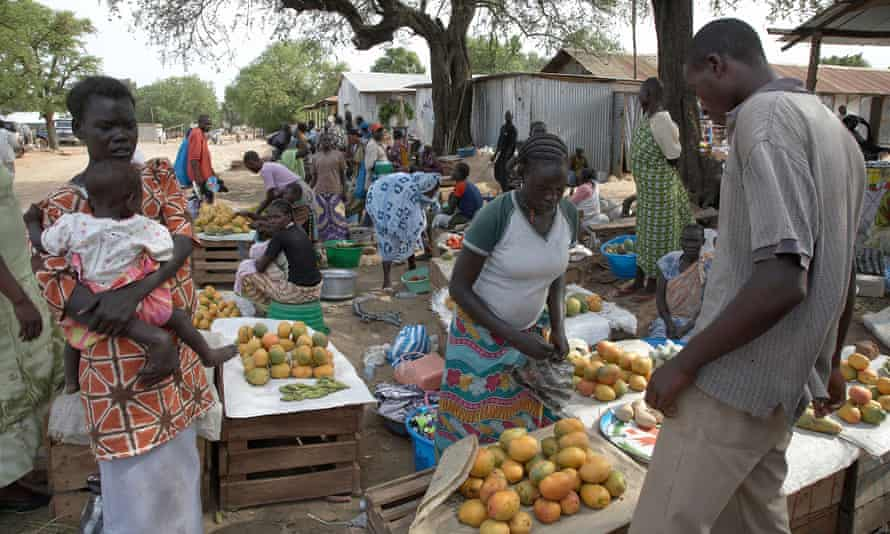 Women work at a fruit and vegetable market in Juba, South Sudan.