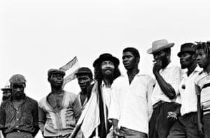 Jamaican rude boys await the arrival of Haile Selassie