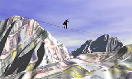 Businessman crossing a financial landscape on a tightrope