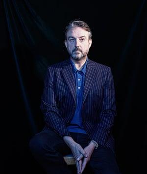non voters - weekend : man in blue blazer against black background
