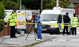 Police and forensic officers seal off Shellingford Road in Dovecot after the shooting