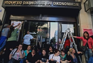 Fired cleaners of the Greek Finance ministry have occupied the ministry   s entrance and shout slogans asking for the implementation of an Athens court ruling that ordered their re-hiring, in Athens, Greece, 22 May 2014.