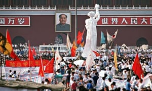 "The ""Goddess of Democracy"" stands tall amid a huge crowd of"