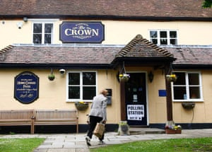 A voter walks into The Crown public house, which is being used as a polling station in South Moreton.