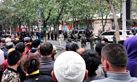 Urumqi street where car and bomb attack occurred cordoned off by police