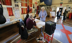 Local residents cast their votes at a polling station in the East Hull Boxing Club in Kingston-Upon-Hull.