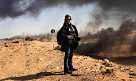 Photographer Lynsey Addario near the frontline during a pause in the fighting in Libya in 2011, a fe