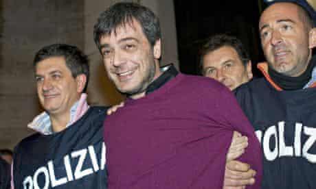 Italian police arrest Camorra mafia boss Antonio Iovine in 2010, after 14 years on the run