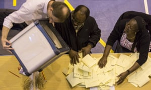 A ballot box containing votes in local elections is emptied at Trinity school in Croydon, England.