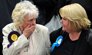 A UKIP supporter chats with a Conservative supporter