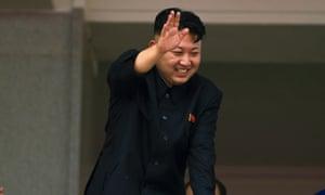 North Korean leader Kim Jong-un waves to Korean War veterans at a military parade in 2013.