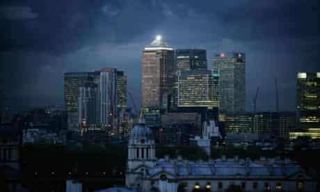 Clouds gather over high-rise buildings in the financial district of the Canary Wharf in east London.