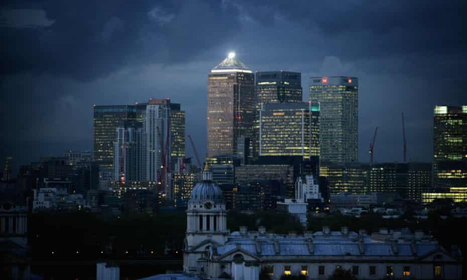 Clouds gather over high-rise buildings in the financial district of Canary Wharf in east London.