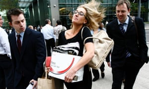 A worker carries a box as she walks away from the Canary Wharf office of the US investment bank Lehman Brothers on 15 September 2008, when the 158-year-old Wall Street firm sought bankruptcy protection.