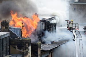 Firefighters continue to extinguish the flames in the Glasgow School of Art after a fire broke out