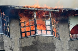 Flames burst through the windows of the Glasgow School of Art after a fire broke out in the building