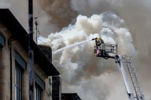 Handout photo issued by David Barz of firefighters tackling a major blaze at Glasgow School of Art's Charles Rennie Mackintosh building.