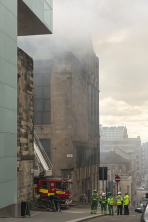 Thick smoke floods Renfrew Street in Glasgow as fire crews fight to save the historic school