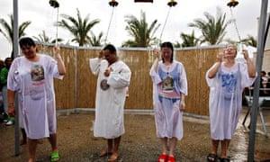 Orthodox Christians celebrate Baptisms during Epiphany at Qasr el Yahud site on Jordan River