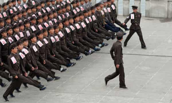 Teenagers during their induction to the Korean People's Army in Pyongyang, North Korea.