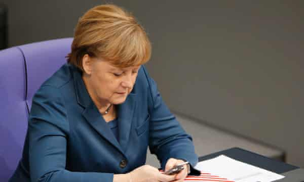 The German chancellor, Angela Merkel, should focus less on her mobile phone and more on whether it is right to deliver all German calls and text messages to the US.