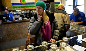 An American ponders the choice of marijuana in Denver after Colorado legalised cannabis in January