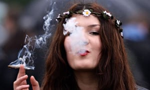 A woman smokes cannabis at a '420 Day' event in London's Hyde Park calling for cannabis legalisation