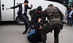 The image of Yusuf Yerkel kicking a protester that went viral