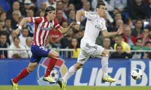 Gareth Bale with Filipe Luis in hot pursuit