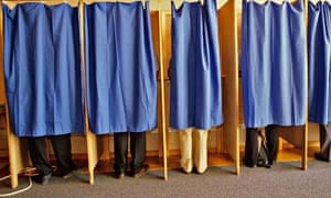 VOTERS VOTE IN A VOTING BOOTH AT A POLLING STATION DURING LOCAL ELECTIONS