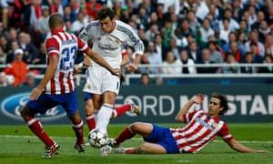 Real Madrid's Gareth Bale pokes his shot wide.