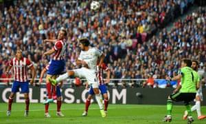 Diego Godin flicks his header goalwards, with Iker Casillas stranded.