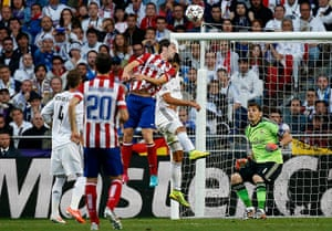 Champions League...: Atletico Madrid's Godin jumps and heads
