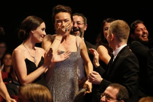 Turkish cast and crew members of Winter Sleep celebrate after the film won the Palme d'Or.